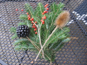 Fir, winterberry, carrion berry, teasel ready to tie on